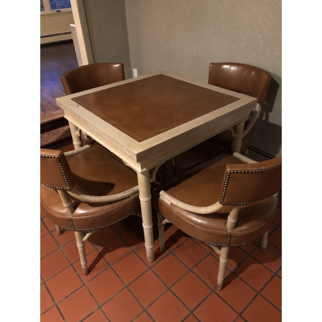 Classic 1940s/1950s bamboo card and game table with 4 matching leather chairs. Table folds out to make a 64 x32 rectangle....