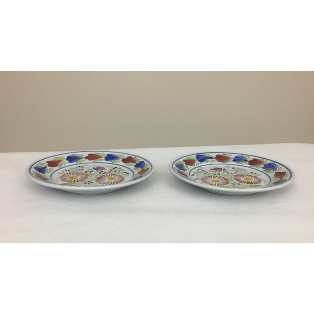 2 Henriot Quimper plates signed by the artist. The pieces are from the late 20th century.