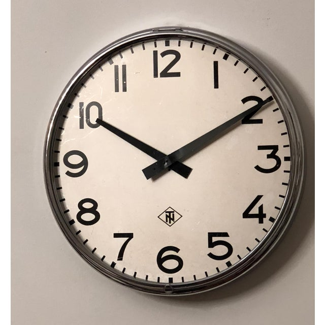 Steel frame painted with an aluminum clock face, clock hand and glass cover. Made in Germany in the late 1970s by TN...