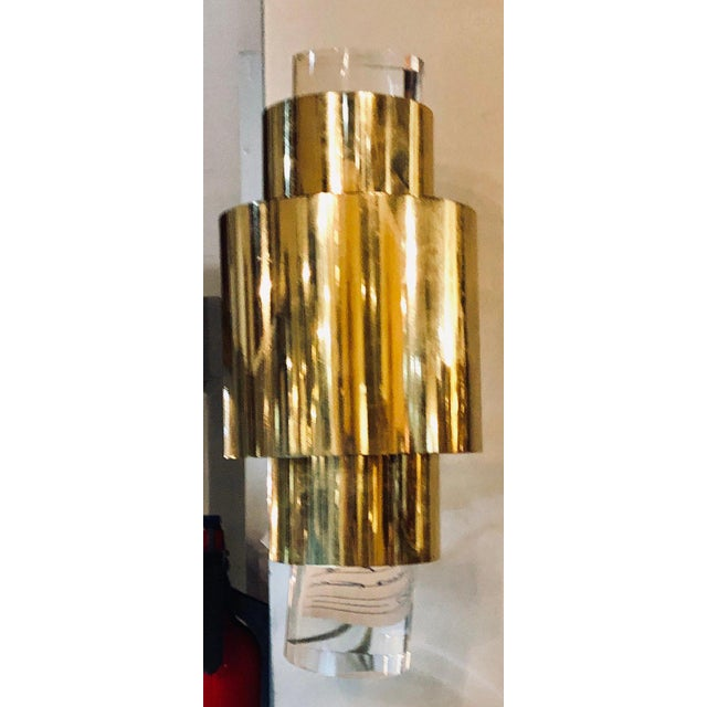 Pair of Karl Springer brass and Lucite wall sconces. These sleek and stylish Mid-Century Modern wall sconce of wall lights...