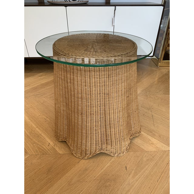 Draped wicker occasional table. Made in the 1960s.