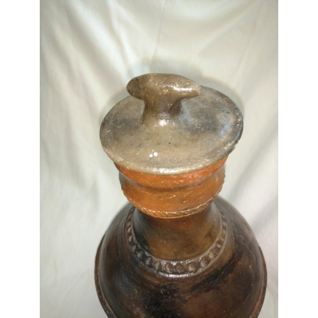 This Antique Terra cotta urn is from Sri Lanka. 1940's era. Has a lid. This piece has some real age to it and you'll see a...