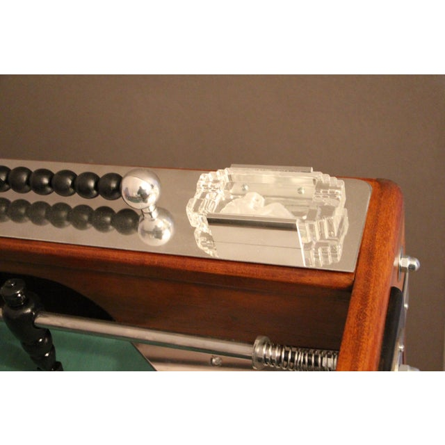 Unusual shape of French foosball table, this item is spectacular. It is in light color wood and blackened wood and...