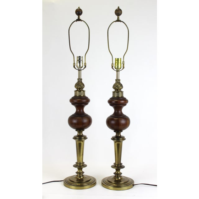 Mid-century pair of Rembrandt lamps with walnut accents and nice patina. Minor wear. Wired and in working condition, it...