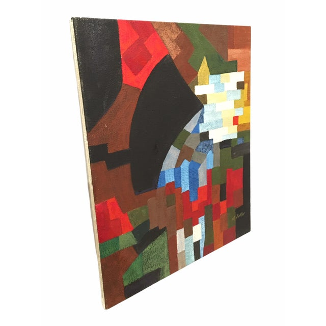Beautiful mid-century painting. This oil on canvas piece features a geometric theme with colors of blue, red, green and...
