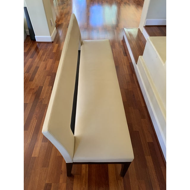 We are the purchaser and only owner of this Holly Hunt Velin leather bench. It was in our formal dining room so it was not...