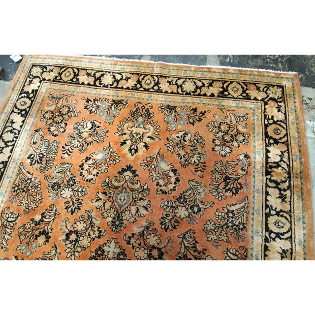 Antique hand made Persian Sarouk rug in salmon shade. The rug is from the beginning of 20th century in original good...