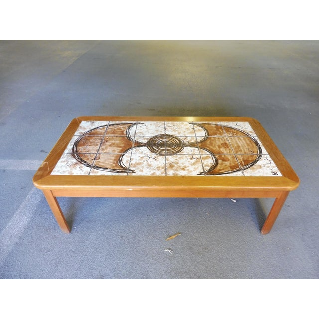 Whimsical abstract painted tile top Danish modern coffee table signed sold as found, unrestored with some aberrations to...