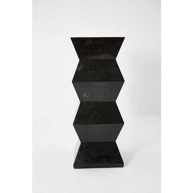 Black tessellated stone pedestal with chiseled accordion shape. Great oversized scale at 46 x 18 x 18 in.