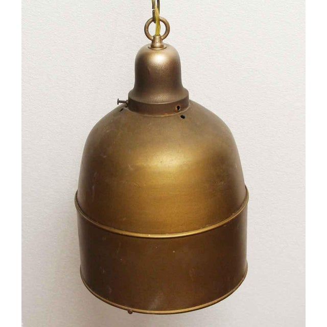 Brass dome shaped single socket pendant light with an antique brass finish. These would look great lined in a row above a...