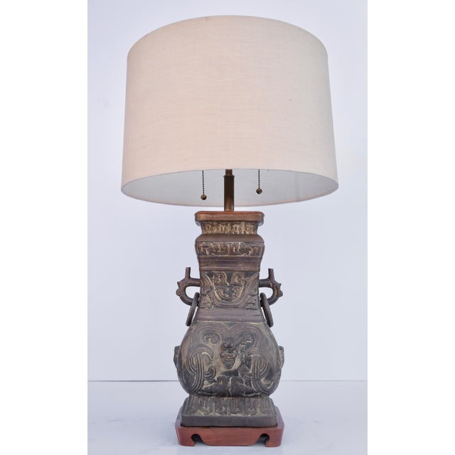 Pair of Asian style bronze lamps with wood bases from the 1940's. Body Height : 18 Overall Height : 31 Width : 8 inches...