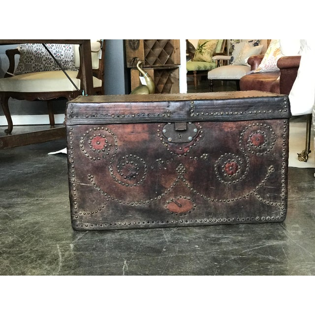 Beautiful Antique leather Bishop's trunk with decorative nail heads, side metal handles.
