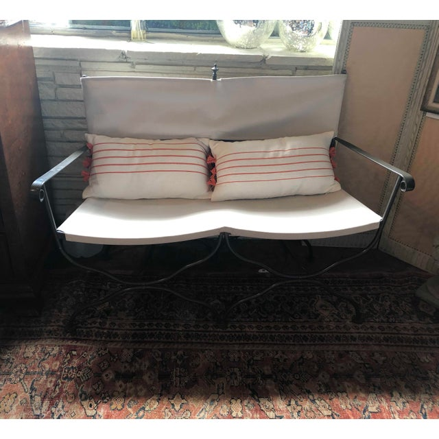 "Campaign style metal bench with two upholstered seats and backs. 48"" Wide x 20"" Deep x 44"" High Seat height 18.5"""