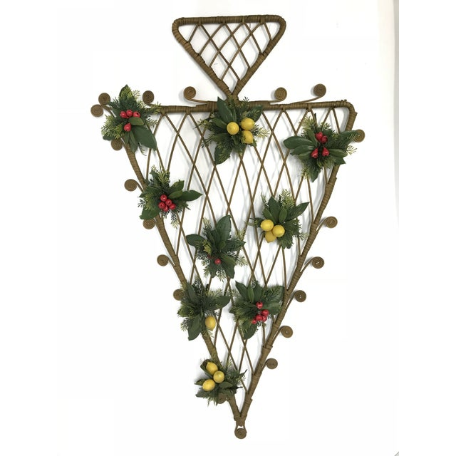 This is a really cute 70's Mid-Century Boho curly rattan Christmas tree wall hanging with silk greenery added. This tree...