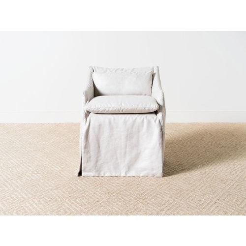 Slipcovered chair on casters with seat cushion and back bolster. Gatsby Silver main fabric: 100% linen. MicroSeal fabric...