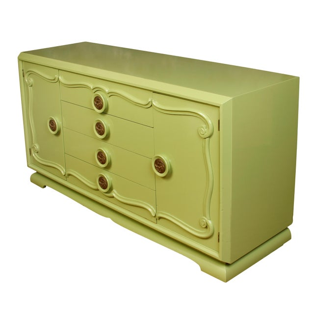 Midcentury painted green credenza, circa 1960. Curved molding and metal swirl round knobs add character to this beautiful,...