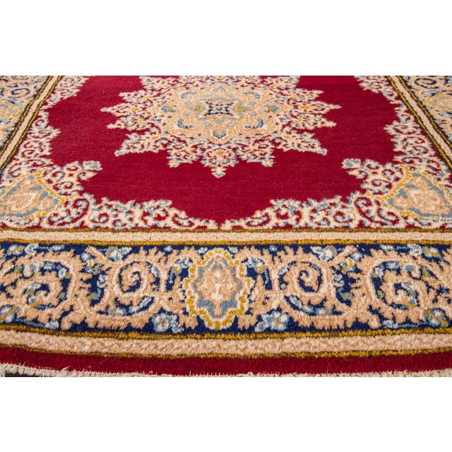 Vintage hand-knotted Kerman rug with a medallion motif. This piece has great colors and a beautiful design. It would be...