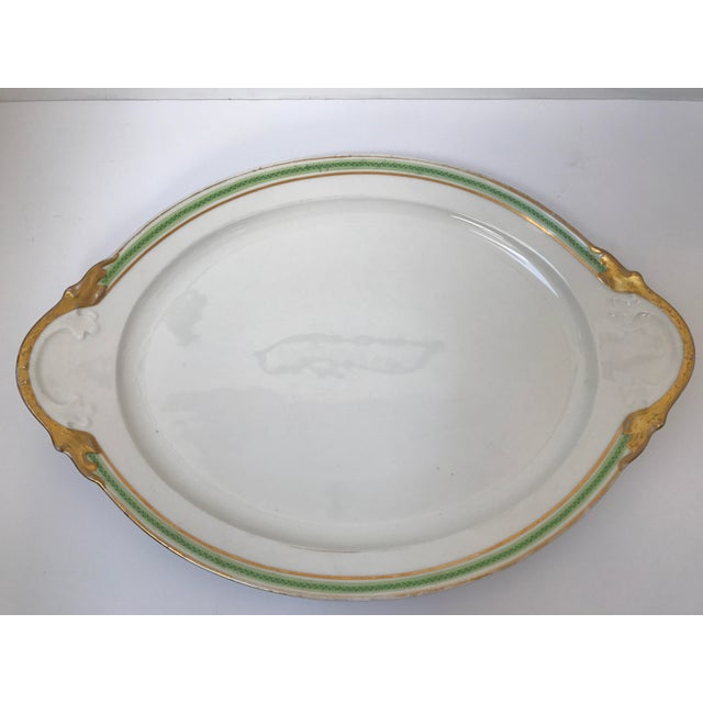 Large Limoges serving platter. Green pattern on rim with gold accent. Good condition and perfect for the holidays.