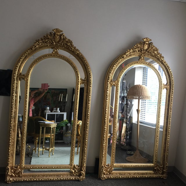 Absolutely stunning large gilded floor mirrors with beveled mirror details and scrolling handcrafted design.