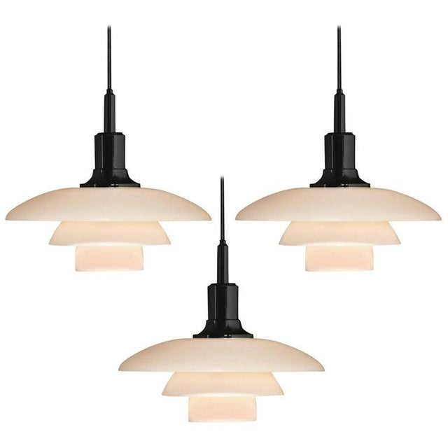 Poul Henningsen opaline glass PH 3½-3 pendant for Louis Poulsen. Executed in white opal glass and a chrome or black...
