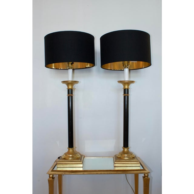 Gorgeous pair of black and gold buffet lamps with square base. Timeless and sophisticated. Come with shallow, mid-century...