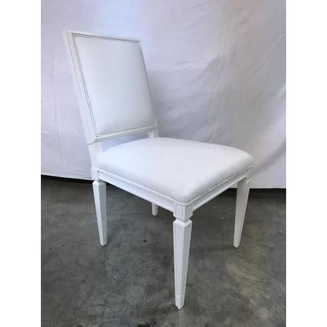 The Jansen Side Chair is a first quality market sample that features a White Fabric with a White Dove Finish.