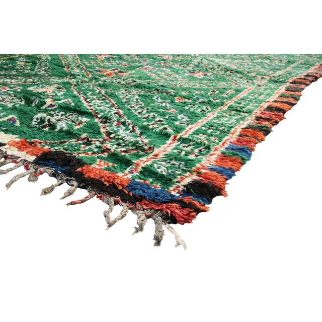 Vintage Azilal rug hand-knotted in the High Atlas Mountains of Morocco with soft organic wool. Featuring an ornate diamond...