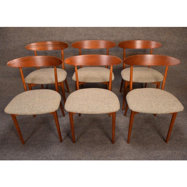 Here is a set of six danish modern dining chairs designed by Kurt Ostervig and manufactured in Denmark in the 1960's by...