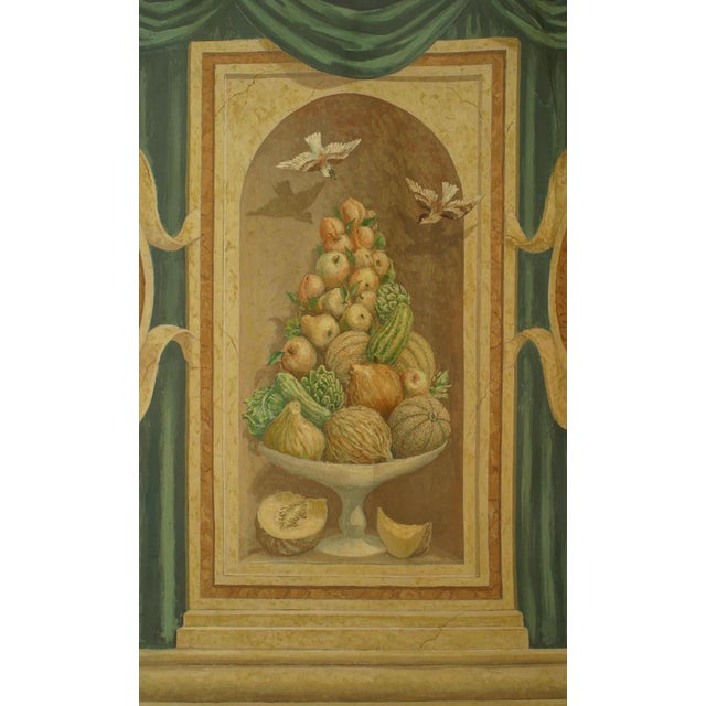 Italian neo-classic style mural painting on canvas of a pair of medallions with cupids centering a still life of fruit...