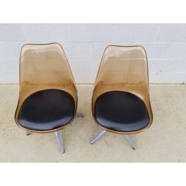 Nice Pair of Swivels Lounge or Side Chairs in Brown Lucite and Alluminum Tripod Legs The Seat Cushion is in Leather These...