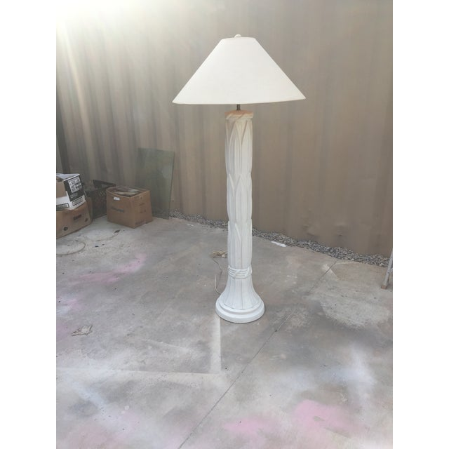 Mid-century plaster floor lamp in the manner of Serge Roache. Bounded palm leaves stalk design with smooth white lacquer...