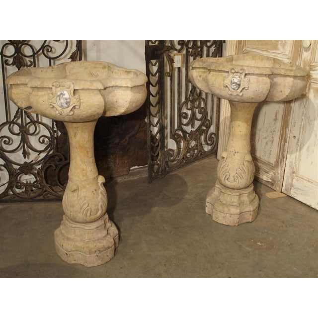 These exquisite Italian Holy Water Vessels or Stoups have been hand carved out of beautiful, old Giallo Reale marble....