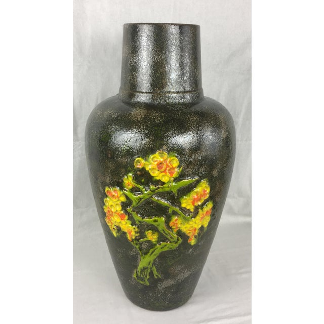 This beautiful Mid-Century vintage floor vase was produced circa 1965 by the renowned producer of West German pottery -...