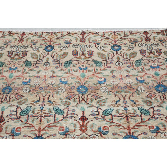 Vintage Turkish hand knotted rug with natural colors and unique pattern.