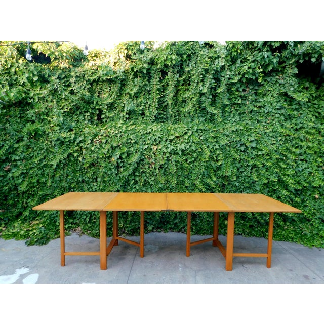 Bruno Mathsson style expanding dining table. The picture of convenience and ingenuity: this beautiful teak dining table...