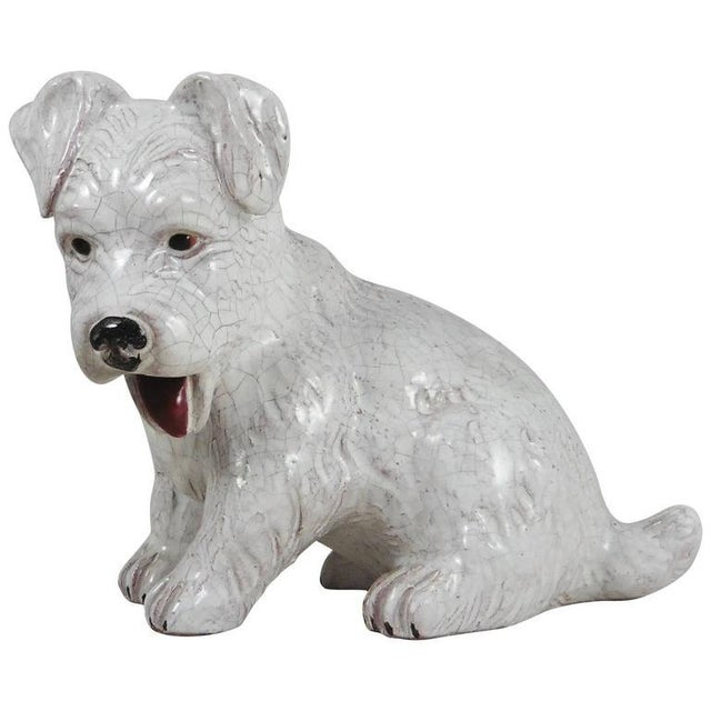 French white terracotta dog circa 1950 attributed to Bavent (Normandy).