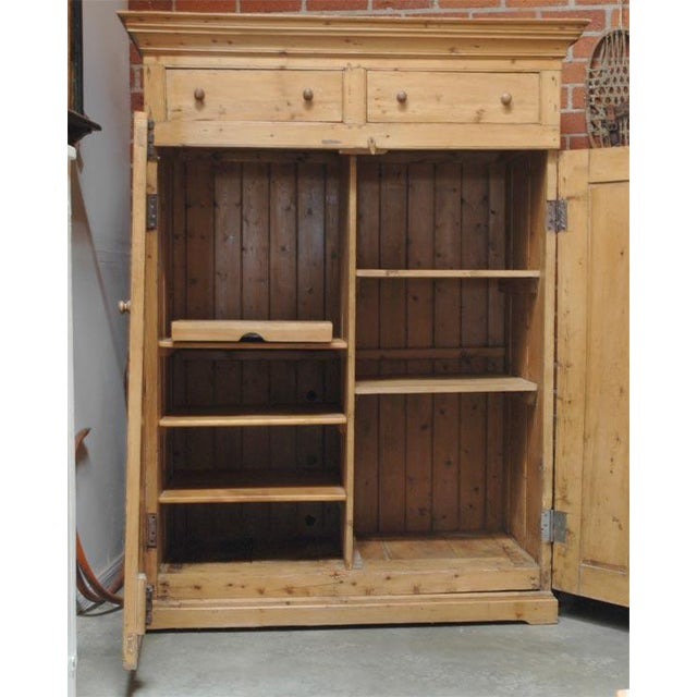 This cabinet has two paneled doors spanning the full width and are situated below two useful drawers. Imported from...