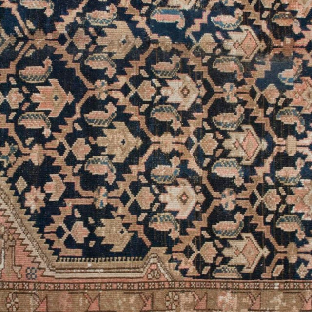 A late 19th century Persian Malayer carpet with central diamond motif on a tree of life background surrounded by an...