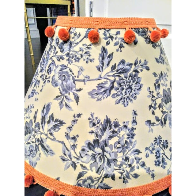 Huge custom blue and white chinoiserie lamp shade with sweet orange ball trim. The shade has that gorgeous blue and white...