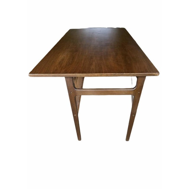 This beautiful Mid-Century Modern desk features sculpted metal pulls, a finished back, and a vintage walnut finish. A...