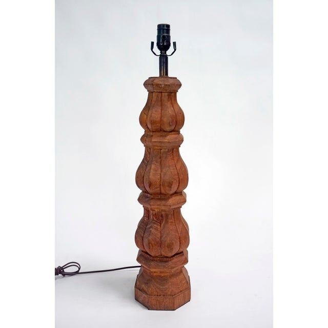 A large, balustrade, hand-carved, redwood table lamp; dark-tinted, brass neck. Dimmer switch on brown cord. Recently...