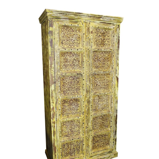 Brilliant yellow Indian antique hand-carved detail wooden cabinet with front 2 door three-shelf cabinet for plenty of...