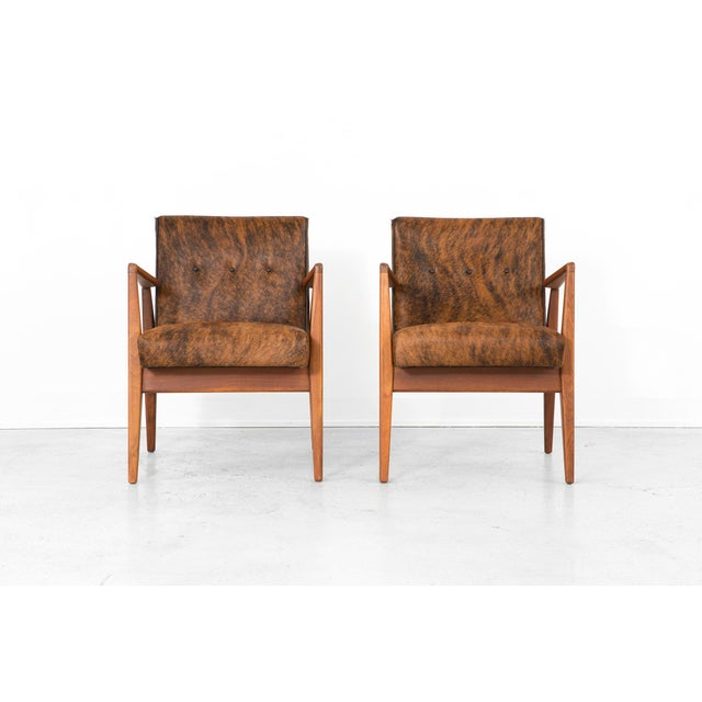 A set of two lounge chairs designed by Jens Risom for Jens Risom Design in the USA, c 1950s. They have been reupholstered...