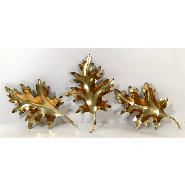 Beautiful metal leaf sculptures to hang on the wall. Nice two tone color. Measurements below are for each.