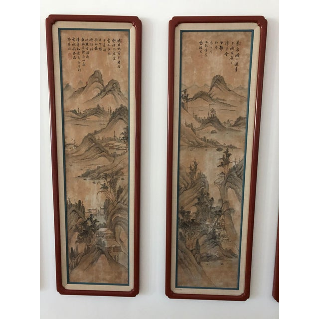 The best I have ever seen of eight hand painted silk panels of landscapes, mounted in red lacquered and matted...
