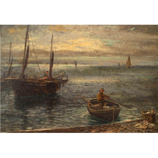 English Victorian bleached and carved framed oil painting of seascape with row boat and sail boats by shore line (signed...