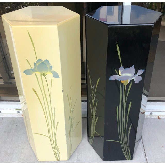 Pair of hexagonal hand painted pedestal made in Taiwan. Elegant flowers pattern. Several small chips on finish. Some...
