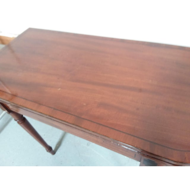Great looking antique mahogany folding game table or side console table. This has dark band details and the top can be...