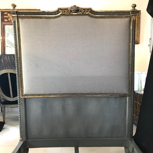 A romantic skillfully carved early 19th century French Louis XV bed having a beautiful original gold gilt and gray antique...
