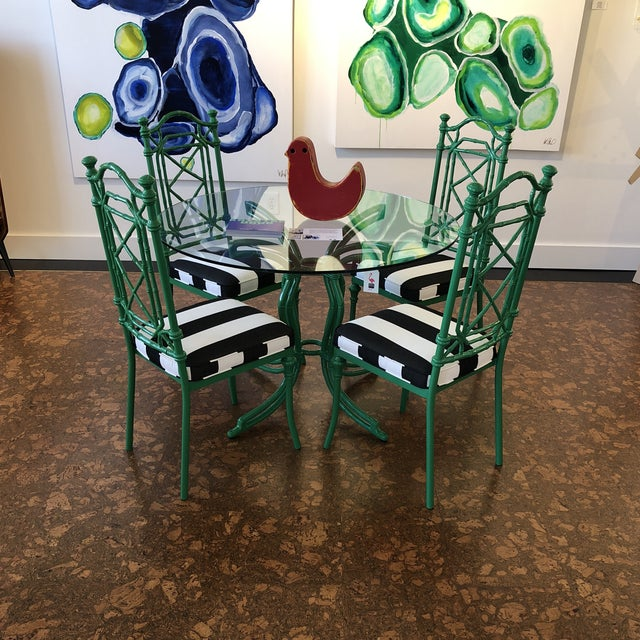 Refinished bamboo look dining table. Powder coated in a glossy Kelly green with Sunbrella Cabana Stripe fabric. Safe to...